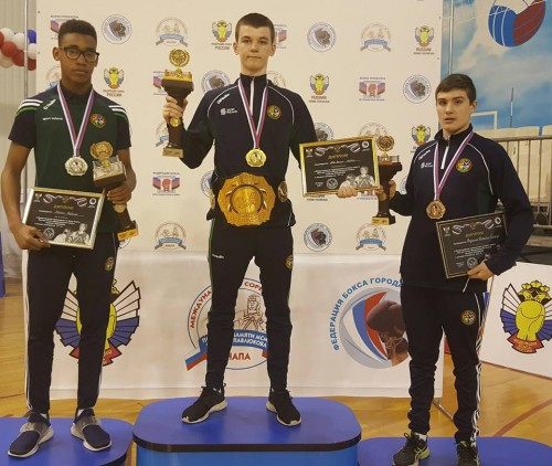 Gabriel Dossen, Aaron McKenna and Eamer Coughlan proudly display their medals today in Anapa