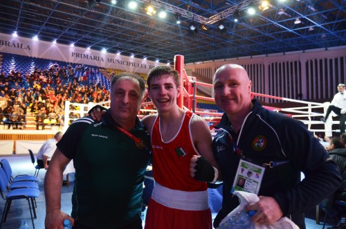 Jordan Moore celebrates victory with Irish coaches Zaur Antia and Pat McDonagh yesterday